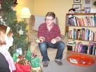 Passing out the gifts from under the tree.