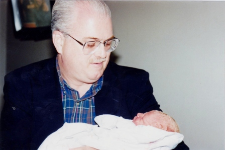 My District Superintendent and friend, Doug holds my daughter just after her birth.