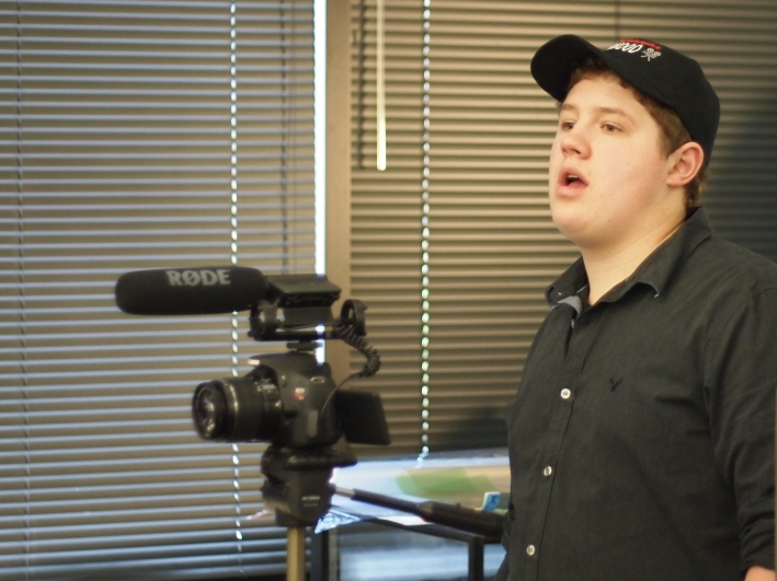 Austin prepares the crew for another take.