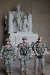 Three young men stop to allow pictures in front of the Lincoln Memorial, December 23, 2013.