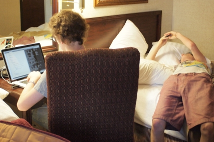 Our first morning in Houston and Ben's lounging, Elliott's programming.