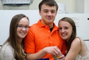 Anna, Joshua and Rebecca pose for a picture in the kitchen.