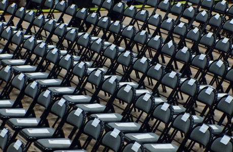 More than 500 chairs await the honored guests.